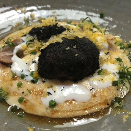 Burnt potato in ash with potato espuma