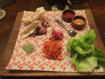 Pig Head Bo-Ssam, Pineapple Kimchi with Miso Dressing, Pickled Daikon, and Bean Powder